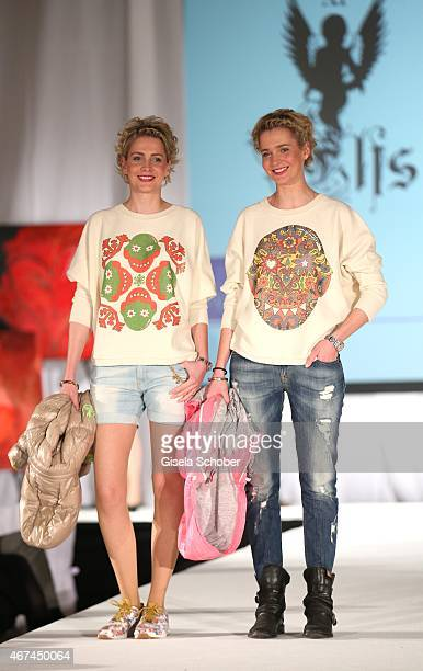 Julia Meise and her twinsister Nina Meise during the SIXT fashion dinner at Nockherberg on March 24 2015 in Munich Germany