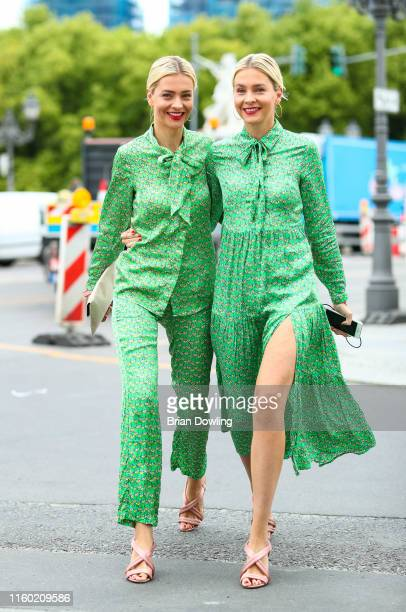 Julia Meise and Nina Meise seen wearing Sem Per Lei dresses as they arrive at the Fashion Brunch on July 05, 2019 in Berlin, Germany.
