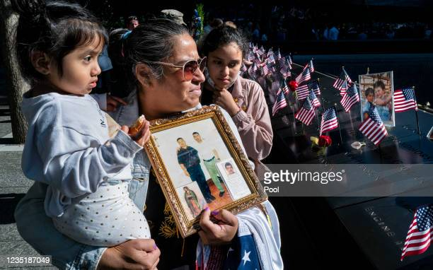 Julia Melendez, holding the photo of her husband Antonio, who died working at Windows on the World restaurant during the attacks of Sept. 11 holds...