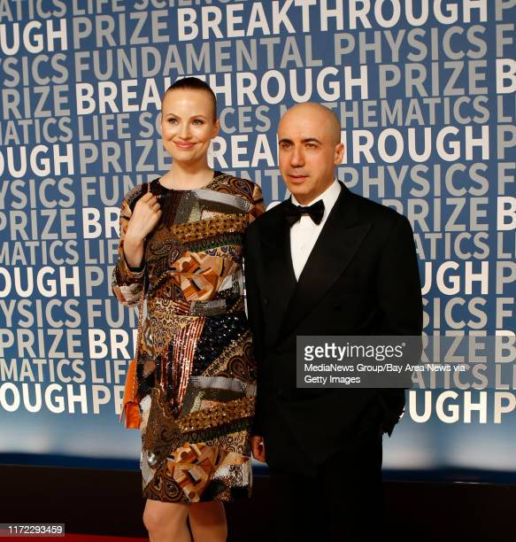 Julia Milner with husband venture capitalist and founder of Digital Sky Technologies Yuri Milner pose for the cameras during the 2016 Breakthrough...