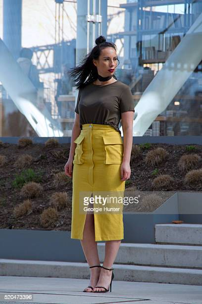 Julia Miriam Lang wearing high waisted yellow skirt with oversized pockets by Zara top by ASOS black strappy sandals by ASOS and black choker...