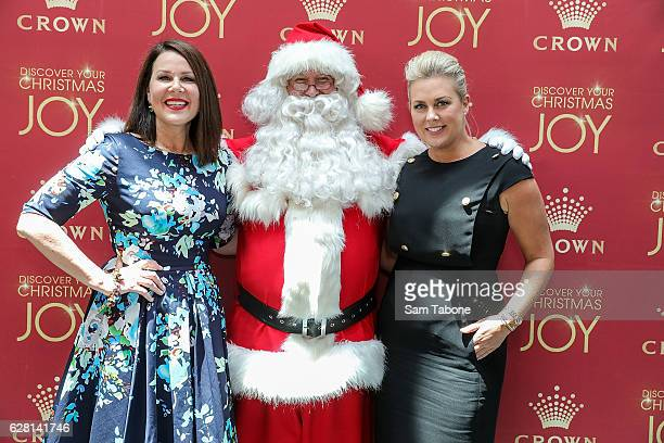 Julia MorrisSanta and Samantha Armytage attends Ann Peacock's Women in Media Christmas Luncheon at The Atlantic at Crown Casino on December 7 2016 in...