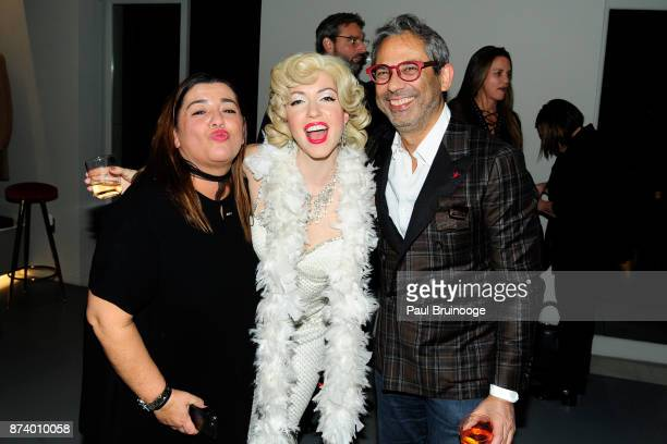 Julia Natale Erika Smith and Gianluca Isaia attend the ISAIA x Guido Lembo birthday event at ISAIA Boutique on November 13 2017 in New York City