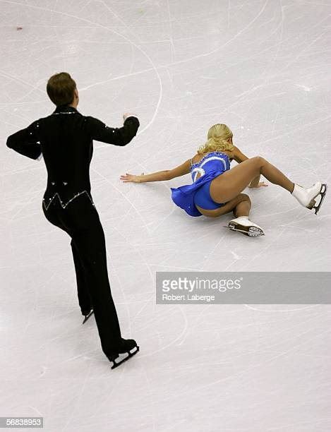 Julia Obertas falls in front of Sergei Slanova of Russia as they compete in the Pairs Free Skating Figure Skating during Day 3 of the Turin 2006...