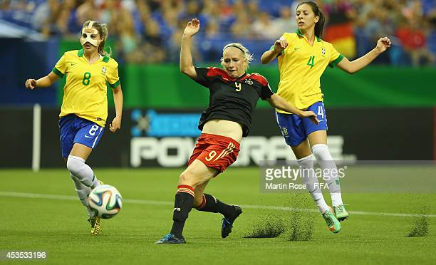 Julia of Brazil and Pauline Bremer of Germany battle for the ball during the FIFA U20 Women's World Cup 2014 group B match between Brazil and Germany...