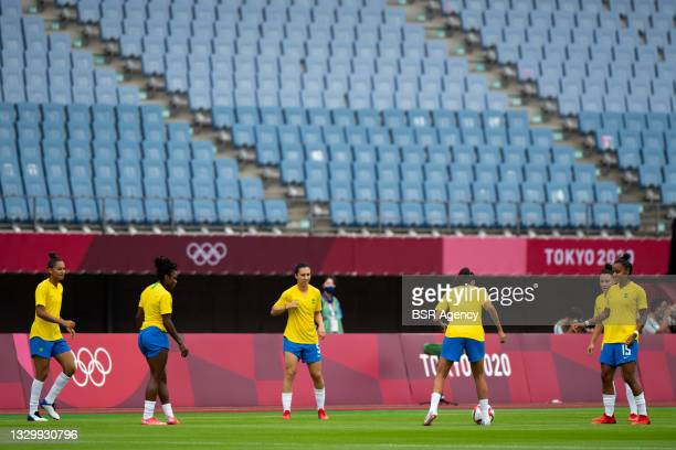 Julia of Brazil warms up with her team mates during the Tokyo 2020 Olympic Football Tournament match between China and Brazil at Miyagi Stadium on...