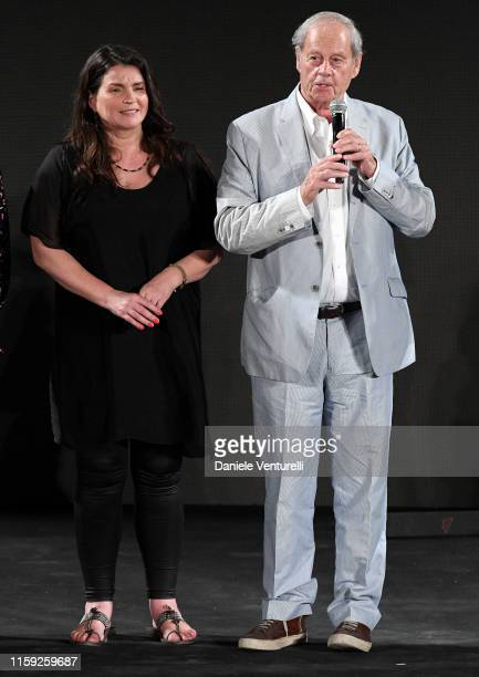Julia Ormond and director Bruce Beresford speaks after receiving the Arte award on stage during the 65th Taormina Film Fest 2019 ceremony on June 30...