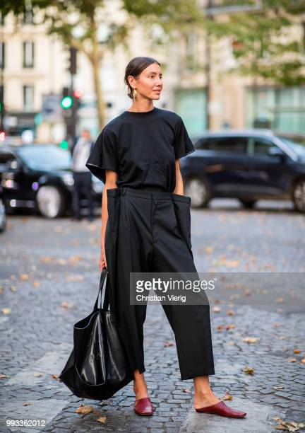 Julia Pelipas wearing black high waist pants black tshirt and bag seen outside Valentino on day four during Paris Fashion Week Haute Couture FW18 on...