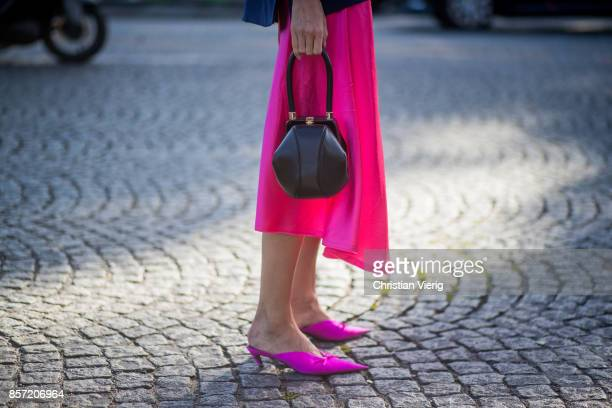 Julia Pelipas wearing pink cropped pants navy blazer jacket seen outside Chanel during Paris Fashion Week Spring/Summer 2018 on October 3 2017 in...