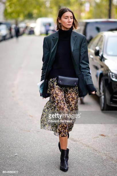 Julia Pelipas wears a balck top a blazer jacket a pleated lace skirt black shoes outside the Rochas show during Paris Fashion Week Womenswear...