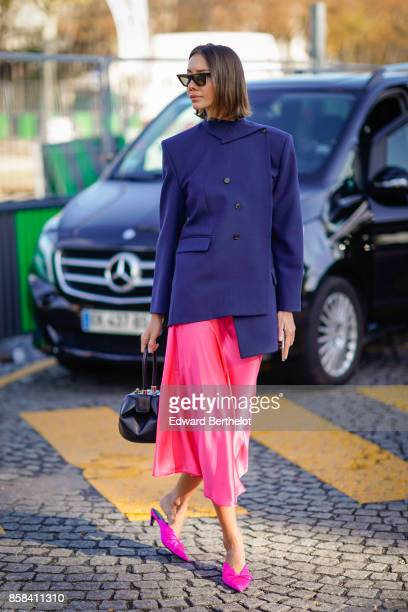 Julia Pelipas wears a blue jacket a pink skirt pink shoes outside Chanel during Paris Fashion Week Womenswear Spring/Summer 2018 on October 3 2017 in...