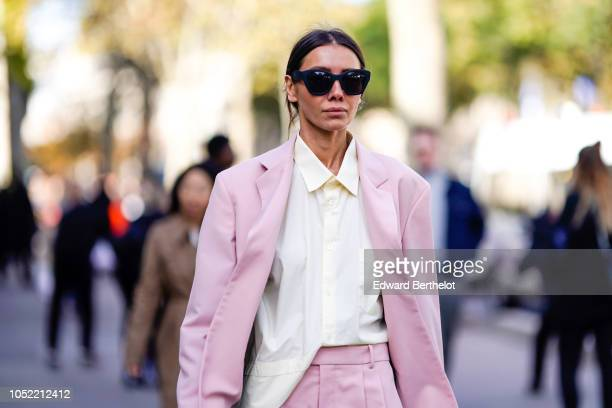 Julia Pelipas wears a pink blazer jacket flare suit pants a white shirt outside Haider Ackermann during Paris Fashion Week Womenswear Spring/Summer...