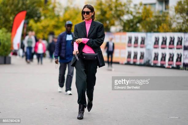 Julia Pelipas wears a pink top a blazer jacket outside Ann Demeulemeester during Paris Fashion Week Womenswear Spring/Summer 2018 on September 28...