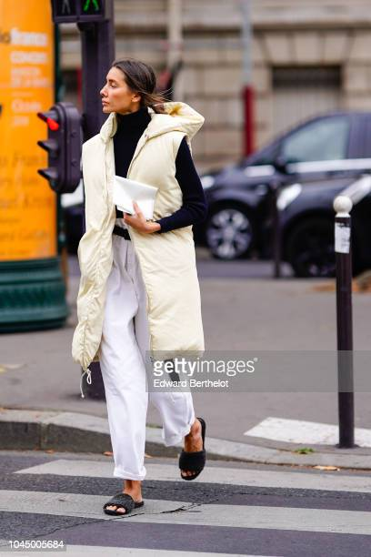 Julia Pelipas wears a white puffer coat white pants sandals outside Miu Miu during Paris Fashion Week Womenswear Spring/Summer 2019 on October 2 2018...