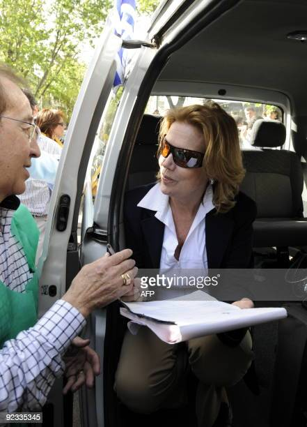 Julia Pou de Lacalle the wife of Uruguayan presidential candidate Luis Alberto Lacalle of the Partido Nacional signs autographs as she waits for her...