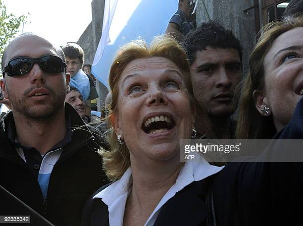 Julia Pou de Lacalle wife of Uruguayan presidential candidate Luis Alberto Lacalle of the Partido Nacional waits for her husband as he votes in...
