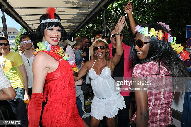 Julia Prillwitz and Sadia De Kiden attend the Christopher Street Day gay pride parade on the P1 truck on July 19 2014 in Munich Germany