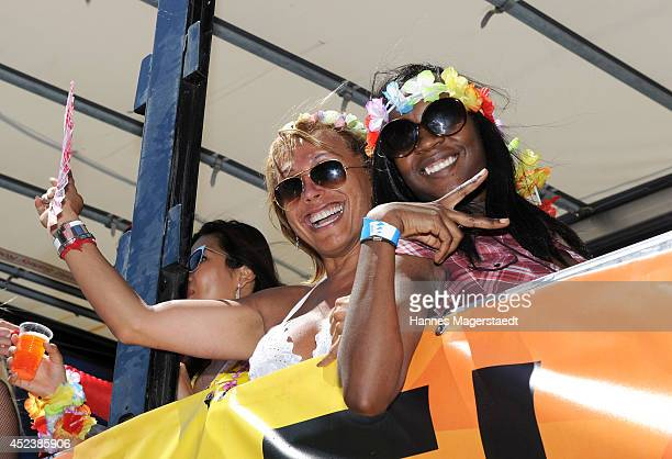 Julia Prillwitz and Sadia De Kiden attends the Christopher Street Day gay pride parade on the P1 truck on July 19 2014 in Munich Germany
