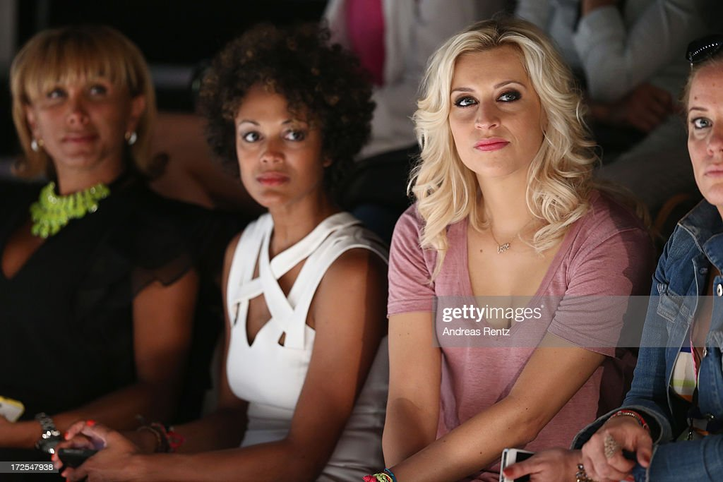 Julia Prillwitz (L), Milka Loff Fernandes (2ndL) and Verena Kerth (2ndR) attend the Dimitri show during the Mercedes-Benz Fashion Week Spring/Summer 2014 at Brandenburg Gate on July 3, 2013 in Berlin, Germany.