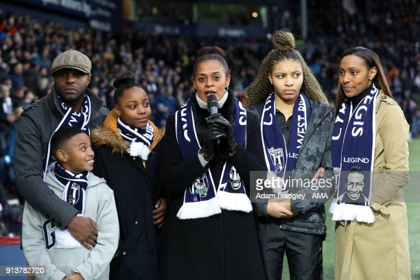 Julia Regis widow of Cyrille Regis with her family lead a thanks to the West Bromwich Albion Fans during the Premier League match between West...