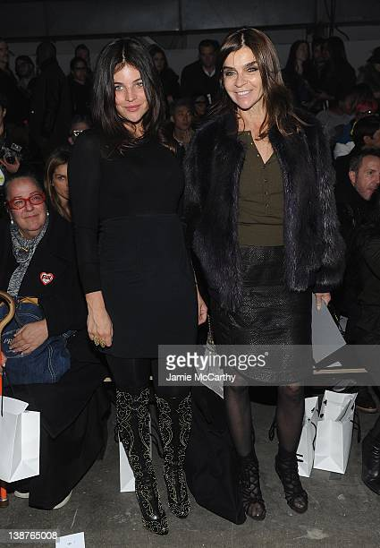 Julia Restoin Roitfeld and Carine Roitfeld attend the Alexander Wang Fall 2012 fashion show during MercedesBenz Fashion Week at the Pier 94 on...