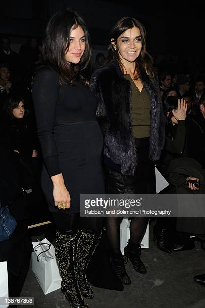 Julia Restoin Roitfeld and Carine Roitfeld attend the Alexander Wang Fall 2012 fashion show during MercedesBenz Fashion Week at Pier 94 on February...