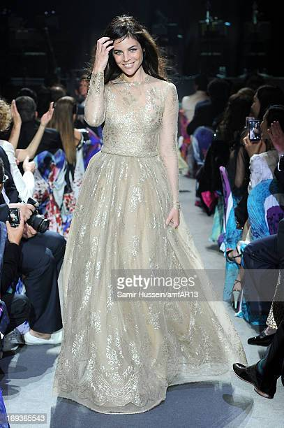 Julia Restoin Roitfeld walks during the fashion show runway as part of amfAR's 20th Annual Cinema Against AIDS during The 66th Annual Cannes Film...