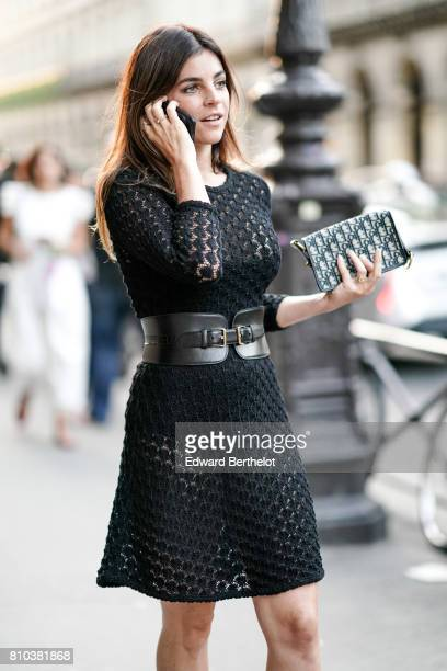 Julia Restoin Roitfeld wears a black lace dress a clutch and a large leather belt outside the 'Christian Dior couturier du reve' Exhibition Launch...