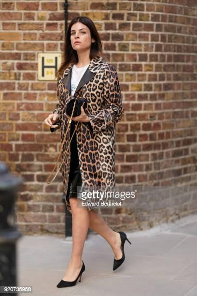 Julia Restoin Roitfeld wears a leopard print coat a Saint Laurent YSL bag during London Fashion Week February 2018 on February 16 2018 in London...
