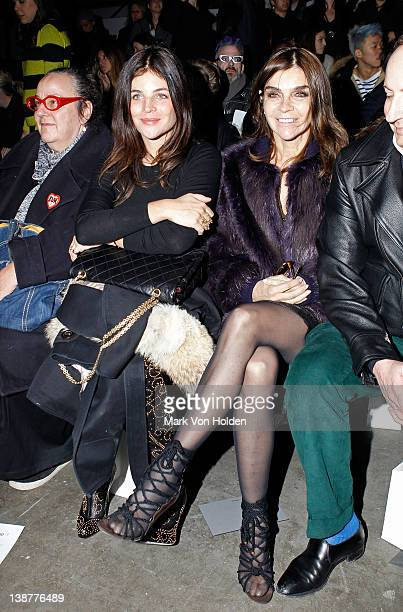 Julia RestoinRoitfeld and Carine Roitfeld attend the Alexander Wang fall 2012 fashion show at Pier 94 on February 11 2012 in New York City