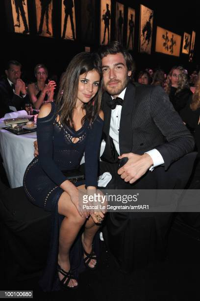 Julia RestoinRoitfeld and Robert Konjic attend amfAR's Cinema Against AIDS 2010 benefit gala dinner at the Hotel du Cap on May 20 2010 in Antibes...