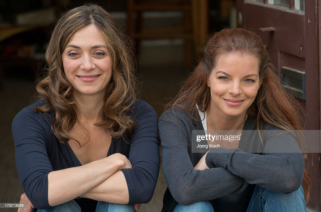 Julia Richter (L) and Yvonne Catterfeld (R) attend the 'Cecelia Ahern' photocall at Glockenbach book store on July 10, 2013 in Munich, Germany.