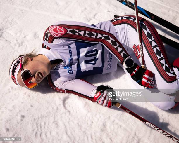 Julia Richter of the University of Utah lies on the ground in the finish area after the women's 15km freestyle at the NCAA Skiing Championships on...