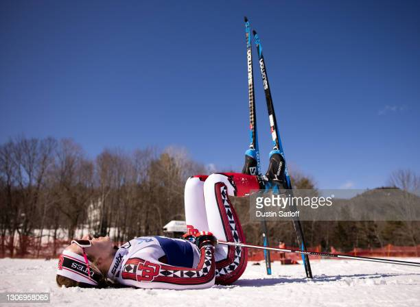 Julia Richter of the University of Utah on the ground in the finish area after the women's 15km freestyle at the NCAA Skiing Championships on March...