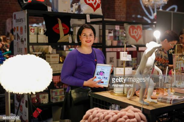 Julia Ritter smiles at her booth during the BlogBoutique XmasEdition on December 3 2017 in Cologne Germany