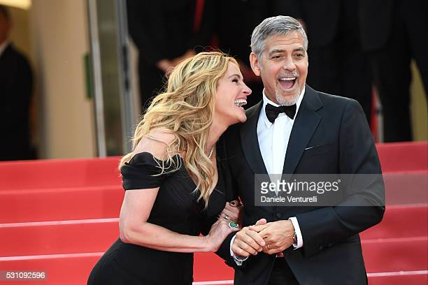 Julia Roberts and Actor George Clooney attend the 'Money Monster' premiere during the 69th annual Cannes Film Festival at the Palais des Festivals on...