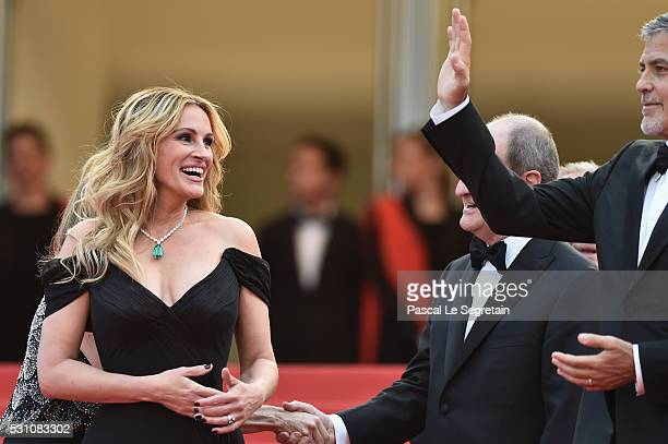 Julia Roberts and George Clooney attend the 'Money Monster' premiere during the 69th annual Cannes Film Festival at the Palais des Festivals on May...