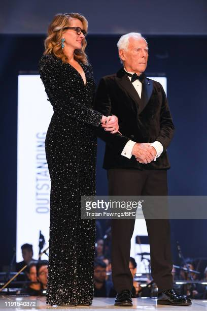 Julia Roberts and Giorgio Armani on stage during The Fashion Awards 2019 held at Royal Albert Hall on December 02 2019 in London England