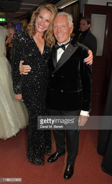 Julia Roberts and Giorgio Armani, winner of the Outstanding Achievement Award, pose backstage stage during The Fashion Awards 2019 held at Royal...