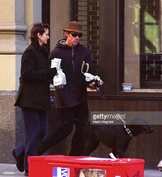 Julia Roberts and her husband Danny Moder walk a dog November 24 2002 in New York City