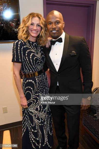 Julia Roberts and Jamie Foxx attend the 47th AFI Life Achievement Award honoring Denzel Washington at Dolby Theatre on June 06 2019 in Hollywood...