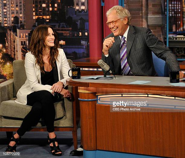 Julia Roberts and Late Show host David Letterman share a laugh during Wednesday's taping of the Late Show with David Letterman August 4, 2010 on the...