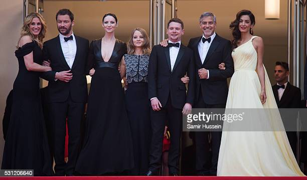 Julia Roberts Dominic West Caitriona Balfe producer Jodie Foster actors Jack O'Connell George Clooney and Amal Clooney attend the screening of Money...