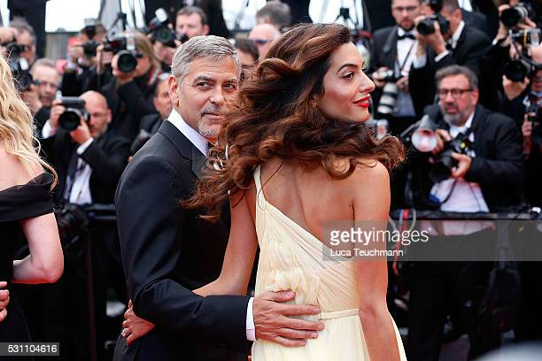 Julia Roberts George Clooney and Amal Clooney attend the screening of 'Money Monster' at the annual 69th Cannes Film Festival at Palais des Festivals...
