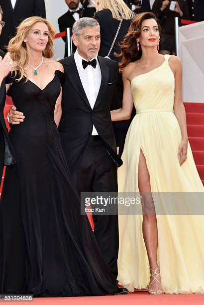 Julia Roberts George Clooney and Amal Clooney attend the'Money Monster' premiere during the 69th annual Cannes Film Festival at the Palais des...