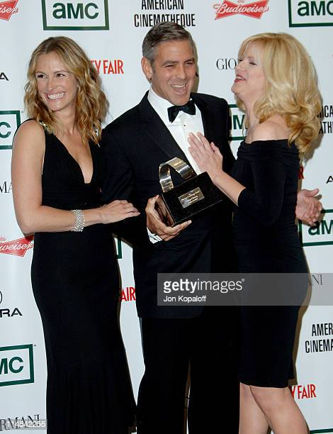 Julia Roberts George Clooney and Bonnie Hunt during The 21st Annual American Cinematheque Award Honoring George Clooney Press Room at Beverly Hilton...