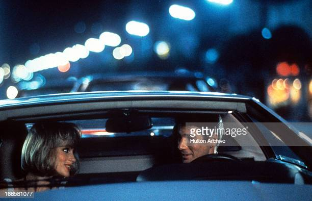 Julia Roberts rides with Richard Gere in a scene from the film 'Pretty Woman' 1990