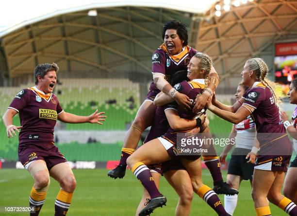 Julia Robinson of the Broncos celebrates her try with Maitua Feterika Heather Ballinger and Broncos teammates during the round three NRLW match...
