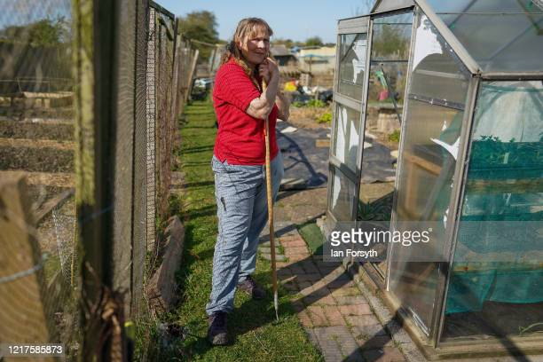 Julia Robinson poses for a photograph as she tends to her allotment and follows government guidelines on social distancing and time restrictions on...
