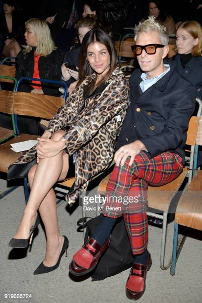 Julia Roitfeld and Drew Elliot wearing Burberry at the Burberry February 2018 show during London Fashion Week at Dimco Buildings on February 17 2018...